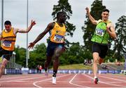 26 June 2021; Israel Olatunde of UCD AC, Dublin, centre, celebrates winning the Men's 100m during day two of the Irish Life Health National Senior Championships at Morton Stadium in Santry, Dublin. Photo by Sam Barnes/Sportsfile