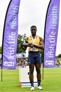 26 June 2021; Israel Olatunde of UCD AC, Dublin, pictured with the trophy after winning the Men's 100m during day two of the Irish Life Health National Senior Championships at Morton Stadium in Santry, Dublin. Photo by Sam Barnes/Sportsfile