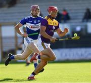 26 June 2021; Lee Chin of Wexford in action against Ciaran Collier of Laois during the Leinster GAA Hurling Senior Championship Quarter-Final match between Wexford and Laois at UPMC Nowlan Park in Kilkenny. Photo by Ray McManus/Sportsfile