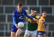 26 June 2021; Stephen Ryan of Clare in action against Seán O'Shea of Kerry during the Munster GAA Football Senior Championship Quarter-Final match between Kerry and Clare at Fitzgerald Stadium in Killarney, Kerry. Photo by Dáire Brennan/Sportsfile
