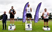 26 June 2021; Athletics Ireland High Performance Chair Fintan Reilly, left, with Men's Discus Medallists, from left, Eoin Sheridan of Clonliffe Harriers AC, Dublin, silver, Colin Quirke of Crusaders AC, Dublin, gold, and Padraig Hore of DMP AC, Wexford, bronze, during day two of the Irish Life Health National Senior Championships at Morton Stadium in Santry, Dublin. Photo by Sam Barnes/Sportsfile