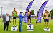26 June 2021; Athletics Ireland Preident John Cronin, left, with Men's 100m medallists, from left, Stephen Gaffney of Rathfarnham WSAF AC, Dublin, silver, Israel Olatunde of UCD AC, Dublin, gold, and Conor Morey of Leevale AC, Cork, bronze, as Tullamore Harriers Chairman Adrian Curley presents the trophy during day two of the Irish Life Health National Senior Championships at Morton Stadium in Santry, Dublin. Photo by Sam Barnes/Sportsfile