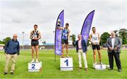 26 June 2021; Sport Ireland chief executive John Treacy, far left, and Athletics Ireland President John Cronin, far right, with Men's 1500m medallists, from left, Cathal Doyle of Clonliffe Harriers AC, Dublin, silver, Andrew Coscoran of Star of the Sea AC, Meath, gold, Kevin Kelly of St. Coca's AC, Kildare, bronze, as Willie Smith presents the cup during day two of the Irish Life Health National Senior Championships at Morton Stadium in Santry, Dublin. Photo by Sam Barnes/Sportsfile