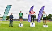 26 June 2021; Minister of State for Sport and the Gaeltacht Jack Chambers, left, with Men's Weight for Distance medallists, from left, John Dwyer of Templemore AC, Tipperary, silver, Sean Breathnach of Galway City Harriers AC, Gold, and Michael Healy of Youghal AC, Cork, bronze, during day two of the Irish Life Health National Senior Championships at Morton Stadium in Santry, Dublin. Photo by Sam Barnes/Sportsfile