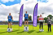 27 June 2021; Athletics Ireland Official John Meagher, right, with Men's Shot Put Medallists, from left, James Kelly of Finn Valley AC, Donegal, silver, Gavin McLaughlin of Finn Valley AC, Donegal, gold, and Sean Breathnach of Galway City Harriers, bronze, during day three of the Irish Life Health National Senior Championships at Morton Stadium in Santry, Dublin. Photo by Sam Barnes/Sportsfile