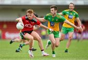 27 June 2021; Liam Kerr of Down in action against Eoghan Ban Gallagher of Donegal during the Ulster GAA Football Senior Championship Preliminary Round match between Down and Donegal at Páirc Esler in Newry, Down. Photo by Ramsey Cardy/Sportsfile
