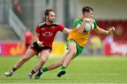 27 June 2021; Michael Langan of Donegal in action against Corey Quinn of Down during the Ulster GAA Football Senior Championship Preliminary Round match between Down and Donegal at Páirc Esler in Newry, Down. Photo by Ramsey Cardy/Sportsfile