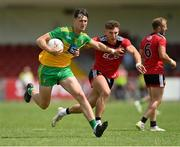 27 June 2021; Michael Langan of Donegal in action against Pierce Laverty of Down during the Ulster GAA Football Senior Championship Preliminary Round match between Down and Donegal at Páirc Esler in Newry, Down. Photo by Ramsey Cardy/Sportsfile