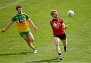 27 June 2021; Danny Savage of Down in action against Eoghan Ban Gallagher of Donegal during the Ulster GAA Football Senior Championship Preliminary Round match between Down and Donegal at Páirc Esler in Newry, Down. Photo by Ramsey Cardy/Sportsfile