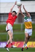27 June 2021; Ciaran Downey of Louth in action against Eoin Carroll of Offaly during the Leinster GAA Football Senior Championship Round 1 match between Louth and Offaly at Páirc Tailteann in Navan, Meath. Photo by David Fitzgerald/Sportsfile