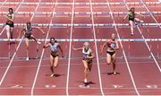 27 June 2021; Sarah Lavin of Emerald AC, Limerick, dips for the line to win the Women's 100m Hurdles, ahead of Kate Doherty of Dundrum South Dublin AC, third from left, who finished second, and Lilly-Ann O'Hora of Dooneen AC, Limerick, second from right, who finished third, during day three of the Irish Life Health National Senior Championships at Morton Stadium in Santry, Dublin. Photo by Sam Barnes/Sportsfile