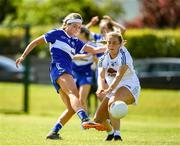 27 June 2021; Eva Galvin of Laois in action against Lara Gilbert of Kildare during the Lidl Ladies Football National League Division 3 Final match between Kildare and Laois at Baltinglass GAA Club in Baltinglass, Wicklow. Photo by Matt Browne/Sportsfile