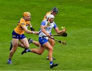 27 June 2021; Neil Montgomery of Waterford is tackled by Clare players David Fitzgerald, left, and Cathal Malone late in the Munster GAA Hurling Senior Championship Quarter-Final match between Waterford and Clare at Semple Stadium in Thurles, Tipperary. Photo by Ray McManus/Sportsfile