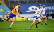 27 June 2021; Austin Gleeson of Waterford in action against Cathal Malone of Clare during the Munster GAA Hurling Senior Championship Quarter-Final match between Waterford and Clare at Semple Stadium in Thurles, Tipperary. Photo by Ray McManus/Sportsfile