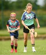 28 June 2021; Kilkenny camogie star, Grace Walsh was on hand with Grainne O'Brien, age 10, in Bruff GAA Club, Limerick to mark the first day of this year's Kellogg's GAA Cúl Camps with numbers of over 130,000 expected to attend across 1,242 camps the length and breadth of the country. The 2021 Kellogg's GAA Cúl Camps offers children a healthy, fun and safe summer outdoor activity at locations nationwide, and will continue until the end of August. Photo by Stephen McCarthy/Sportsfile