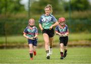 28 June 2021; Kilkenny camogie star, Grace Walsh was on hand with Grainne O'Brien, age 10, left, and Rachel McAuliffe, age 10, in Bruff GAA Club, Limerick to mark the first day of this year's Kellogg's GAA Cúl Camps with numbers of over 130,000 expected to attend across 1,242 camps the length and breadth of the country. The 2021 Kellogg's GAA Cúl Camps offers children a healthy, fun and safe summer outdoor activity at locations nationwide, and will continue until the end of August. Photo by Stephen McCarthy/Sportsfile