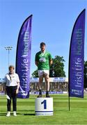 27 June 2021; Athletic's Ireland Competition Committee Member Patricia Griffin with Junior Men's Weight for Height gold medallist Patrick Corrigan of Suncroft AC, Kildare, during day three of the Irish Life Health National Senior Championships at Morton Stadium in Santry, Dublin. Photo by Sam Barnes/Sportsfile
