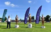27 June 2021; Athletics Ireland Chair of Competition Andrew Lynam, left, with Women's 100m medallists, from left, Kate Doherty, Dundrum South Dublin AC, silver, Sarah Lavin of Emerald AC, Limerick, gold, and Lilly-Ann O'Hora of Dooneen AC, Limerick, bronze, during day three of the Irish Life Health National Senior Championships at Morton Stadium in Santry, Dublin. Photo by Sam Barnes/Sportsfile