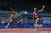 27 June 2021; Kate Doherty of Dundrum South Dublin AC, left, and Lilly-Ann O'Hora of Dooneen AC, Limerick, cross the finish line to finish second and third respectively in the Women's 100m Hurdles during day three of the Irish Life Health National Senior Championships at Morton Stadium in Santry, Dublin. Photo by Sam Barnes/Sportsfile