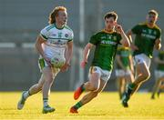 30 June 2021; Cormac Egan of Offaly in action against Ben Donnelly of Meath during the Electric Ireland Leinster GAA Football Minor Championship Final match between Meath and Offaly at TEG Cusack Park in Mullingar, Westmeath. Photo by Matt Browne/Sportsfile