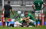 3 July 2021; Peter O'Mahony of Ireland checks on the well-being of team-mate Chris Farrell during the International Rugby Friendly match between Ireland and Japan at Aviva Stadium in Dublin. Photo by David Fitzgerald/Sportsfile