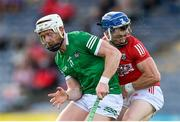 3 July 2021; Sean O'Donoghue of Cork is tackled by Cian Lynch of Limerick during the Munster GAA Hurling Senior Championship Semi-Final match between Cork and Limerick at Semple Stadium in Thurles, Tipperary. Photo by Stephen McCarthy/Sportsfile