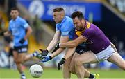 4 July 2021; Paddy Small of Dublin in action against Daithí Waters of Wexford during the Leinster GAA Football Senior Championship Quarter-Final match between Wexford and Dublin at Chadwicks Wexford Park in Wexford. Photo by Brendan Moran/Sportsfile