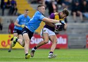 4 July 2021; Brian Malone of Wexford is tackled by Paddy Small of Dublin during the Leinster GAA Football Senior Championship Quarter-Final match between Wexford and Dublin at Chadwicks Wexford Park in Wexford. Photo by Brendan Moran/Sportsfile