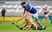 4 July 2021; Dan McCormack of Tipperary in action against Cathal Malone of Clare during the Munster GAA Hurling Senior Championship Semi-Final match between Tipperary and Clare at LIT Gaelic Grounds in Limerick. Photo by Stephen McCarthy/Sportsfile