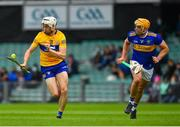 4 July 2021; Ryan Taylor of Clare in action against Ronan Maher of Tipperary during the Munster GAA Hurling Senior Championship Semi-Final match between Tipperary and Clare at LIT Gaelic Grounds in Limerick. Photo by Ray McManus/Sportsfile