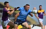 4 July 2021; Paddy Small of Dublin in action against Eoin Porter of Wexford during the Leinster GAA Football Senior Championship Quarter-Final match between Wexford and Dublin at Chadwicks Wexford Park in Wexford. Photo by Brendan Moran/Sportsfile