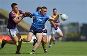 4 July 2021; Paddy Small of Dublin in action against Brian Malone and Eoin Porter of Wexford during the Leinster GAA Football Senior Championship Quarter-Final match between Wexford and Dublin at Chadwicks Wexford Park in Wexford. Photo by Brendan Moran/Sportsfile