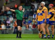 4 July 2021; Cathal Malone, Conor Cleary and John Conlon of Clare look on as referee James Owens awards a penalty to Tipperary during the Munster GAA Hurling Senior Championship Semi-Final match between Tipperary and Clare at LIT Gaelic Grounds in Limerick. Photo by Ray McManus/Sportsfile