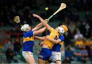 4 July 2021; Aron Shanagher of Clare in action against Padraic Maher, left, and Barry Heffernan of Tipperary during the Munster GAA Hurling Senior Championship Semi-Final match between Tipperary and Clare at LIT Gaelic Grounds in Limerick. Photo by Stephen McCarthy/Sportsfile