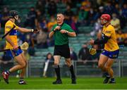 4 July 2021; Cathal Malone, left, and John Conlon appeal to referee James Owens before he awarded a penalty to Tipperary after their team-mate Aidan McCarthy was shown a yellow card during the Munster GAA Hurling Senior Championship Semi-Final match between Tipperary and Clare at LIT Gaelic Grounds in Limerick. Photo by Ray McManus/Sportsfile