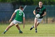 7 July 2021; Stephen Cluxton of Parnells in action against Ciarán Brabazon of O'Tooles during the Go Ahead Adult Football League Division Three North match between Parnells and O'Tooles at Parnells GAA Club in Coolock, Dublin. Photo by Piaras Ó Mídheach/Sportsfile