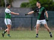 7 July 2021; Stephen Cluxton of Parnells bumps fists with Ciarán Gethings of O'Tooles after the Go Ahead Adult Football League Division Three North match between Parnells and O'Tooles at Parnells GAA Club in Coolock, Dublin. Photo by Piaras Ó Mídheach/Sportsfile