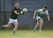 7 July 2021; Stephen Cluxton of Parnells in action against Andrew Morris of O'Tooles during the Go Ahead Adult Football League Division Three North match between Parnells and O'Tooles at Parnells GAA Club in Coolock, Dublin. Photo by Piaras Ó Mídheach/Sportsfile