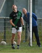 7 July 2021; Stephen Cluxton of Parnells looks on, alongside umpire Martin Flanagan, during the Go Ahead Adult Football League Division Three North match between Parnells and O'Tooles at Parnells GAA Club in Coolock, Dublin. Photo by Piaras Ó Mídheach/Sportsfile