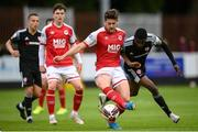 9 July 2021; Sam Bone of St Patrick's Athletic in action against Junior Ogedi-Uzokwe of Derry City during the SSE Airtricity League Premier Division match between St Patrick's Athletic and Derry City at Richmond Park in Dublin. Photo by Stephen McCarthy/Sportsfile