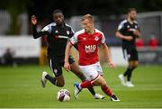 9 July 2021; Jamie Lennon of St Patrick's Athletic in action against Junior Ogedi-Uzokwe of Derry City during the SSE Airtricity League Premier Division match between St Patrick's Athletic and Derry City at Richmond Park in Dublin. Photo by Stephen McCarthy/Sportsfile