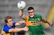 10 July 2021; Seán O'Shea of Kerry is tackled by Brian Fox of Tipperary during the Munster GAA Football Senior Championship Semi-Final match between Tipperary and Kerry at Semple Stadium in Thurles, Tipperary. Photo by Piaras Ó Mídheach/Sportsfile
