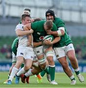 10 July 2021; Gavin Coombes of Ireland, with the help of team-mate Tom O'Toole, is tackled by Luke Carty of USA during the International Rugby Friendly match between Ireland and USA at the Aviva Stadium in Dublin. Photo by Brendan Moran/Sportsfile