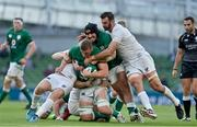 10 July 2021; Gavin Coombes of Ireland, with the help of team-mate Tom O'Toole, is tackled by Luke Carty , left, and Nick Civetta of USA during the International Rugby Friendly match between Ireland and USA at the Aviva Stadium in Dublin. Photo by Brendan Moran/Sportsfile