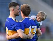 10 July 2021; Brian Fox of Tipperary with his son Tadhg, and team-mate Shane O'Connell, after the Munster GAA Football Senior Championship Semi-Final match between Tipperary and Kerry at Semple Stadium in Thurles, Tipperary. Photo by Piaras Ó Mídheach/Sportsfile