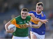 10 July 2021; Seán O'Shea of Kerry is tackled by Shane O'Connell of Tipperary during the Munster GAA Football Senior Championship Semi-Final match between Tipperary and Kerry at Semple Stadium in Thurles, Tipperary. Photo by Piaras Ó Mídheach/Sportsfile