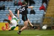 11 July 2021; Darren Coen of Mayo shoots to score his side's first goal despite the efforts of Leitrim goalkeeper Brendan Flynn during the Connacht GAA Senior Football Championship Semi-Final match between Leitrim and Mayo at Elverys MacHale Park in Castlebar, Mayo. Photo by Harry Murphy/Sportsfile
