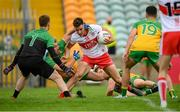 11 July 2021; Shane McGuigan of Derry in action against Stephen McMenamin during the Ulster GAA Football Senior Championship Quarter-Final match between Derry and Donegal at Páirc MacCumhaill in Ballybofey, Donegal. Photo by Stephen McCarthy/Sportsfile