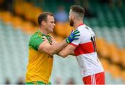 11 July 2021; Neil McGee of Donegal and Niall Loughlin of Derry during the Ulster GAA Football Senior Championship Quarter-Final match between Derry and Donegal at Páirc MacCumhaill in Ballybofey, Donegal. Photo by Stephen McCarthy/Sportsfile