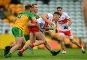 11 July 2021; Shane McGuigan of Derry in action against Stephen McMenamin, 4, and Neil McGee of Donegal during the Ulster GAA Football Senior Championship Quarter-Final match between Derry and Donegal at Páirc MacCumhaill in Ballybofey, Donegal. Photo by Stephen McCarthy/Sportsfile